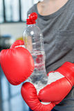 Preteen child in boxing gloves with sport bottle Royalty Free Stock Photography
