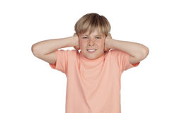 Preteen covering his ears Royalty Free Stock Photo