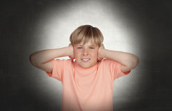 Preteen covering his ears Stock Photo