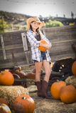 Preteen Cowgirl Portrait at the Pumpkin Patch Stock Image