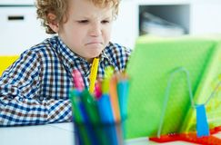 Preteen curly Caucasian boy have nervous breakdown because of di. Fficult large homework. Education, childhood, people, homework and school concept Royalty Free Stock Photos