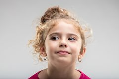 Preteen curly girl looking away Royalty Free Stock Images