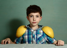 Preteen cute boy play with grape fruit halfs Stock Photography