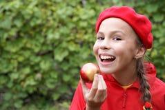preteen della ragazza della mela Fotografia Stock
