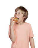 Preteen eating a red apple Stock Images