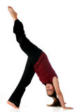 Preteen Exerciser. An upside down preteen girl stretching her legs.  Isolated on white Royalty Free Stock Images