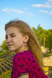Preteen female outdoors on a sunny, breezy day Stock Images
