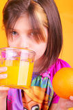 Preteen and Fresh Orange Juice Royalty Free Stock Images