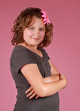 Preteen girl. Portrait of a cute preteen girl, pink background Stock Image