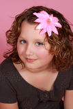 Preteen girl. Portrait of a cute preteen gil, pink background Royalty Free Stock Photography