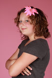 Preteen girl. Cute caucasian preteen girl, pink background Royalty Free Stock Photos