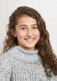 Preteen girl. Adorable happy preteen girl in sweater studio portrait Royalty Free Stock Image