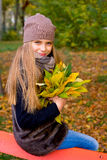 Preteen girl in autumn park with leafs Royalty Free Stock Images