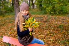 Preteen girl in autumn park with leafs Stock Image