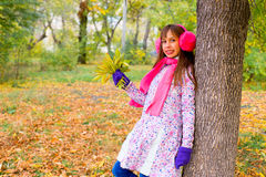 Preteen girl in autumn park with leafs Royalty Free Stock Photography