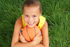 Preteen girl with basketball Stock Photos