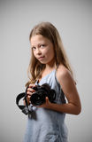 Preteen girl with a big camera Royalty Free Stock Photos
