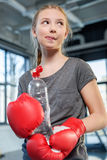 Preteen girl in boxing gloves with sport bottle Stock Photo