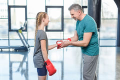 Preteen girl boxing with senior trainer Stock Photography