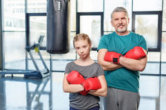 Preteen girl boxing with senior trainer Stock Images