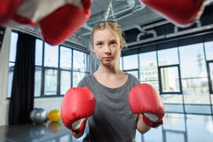 Preteen girl boxing with senior trainer Stock Image