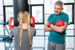 Preteen girl boxing with senior trainer Royalty Free Stock Images