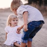 Preteen girl and boy holding their hands Stock Photo