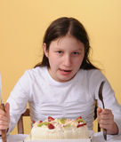 Preteen girl and a cake Stock Images
