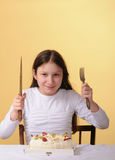 Preteen girl and a cake Stock Photos