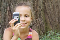 Preteen girl with cell phone Stock Images