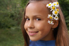 Preteen girl with chamomile Royalty Free Stock Image