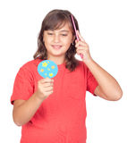 Preteen girl combing with a comb Royalty Free Stock Photos