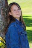 Preteen girl in denim jacket stock photo