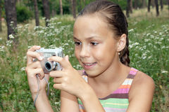 Preteen girl with digital camera Royalty Free Stock Photo