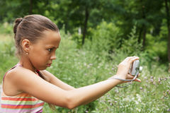 Preteen girl with digital camera Royalty Free Stock Photos