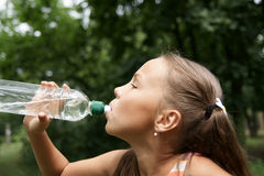 Preteen girl drinking watter Stock Photo
