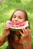Preteen girl eats watermellon Royalty Free Stock Photo