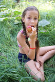 Preteen girl eatting apple. Preteen girl holding a fresh apple Royalty Free Stock Images