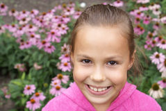 Preteen girl with flowers Stock Photography