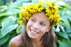 Preteen girl in garland Royalty Free Stock Image