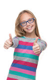 Preteen girl in a glasses with her thumbs up Stock Photography