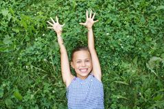 Preteen girl on grass Royalty Free Stock Photography