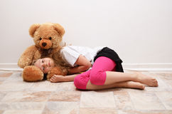 Preteen girl with her teddy bear Stock Image
