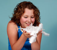 Preteen girl holding white feathers. Caucasian preteen gill holding some white feathers Stock Photo