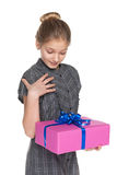 Preteen girl holds a gift box Royalty Free Stock Images