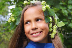 Preteen girl with hops Stock Images