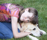 Preteen girl hugging dog Royalty Free Stock Image