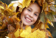Preteen girl in leaf garland Stock Photo