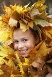 Preteen girl in leaf garland Stock Photography