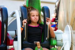 PreTeen Girl Looks Either Bored or Naseous on a Fast Spinning Ri royalty free stock photography